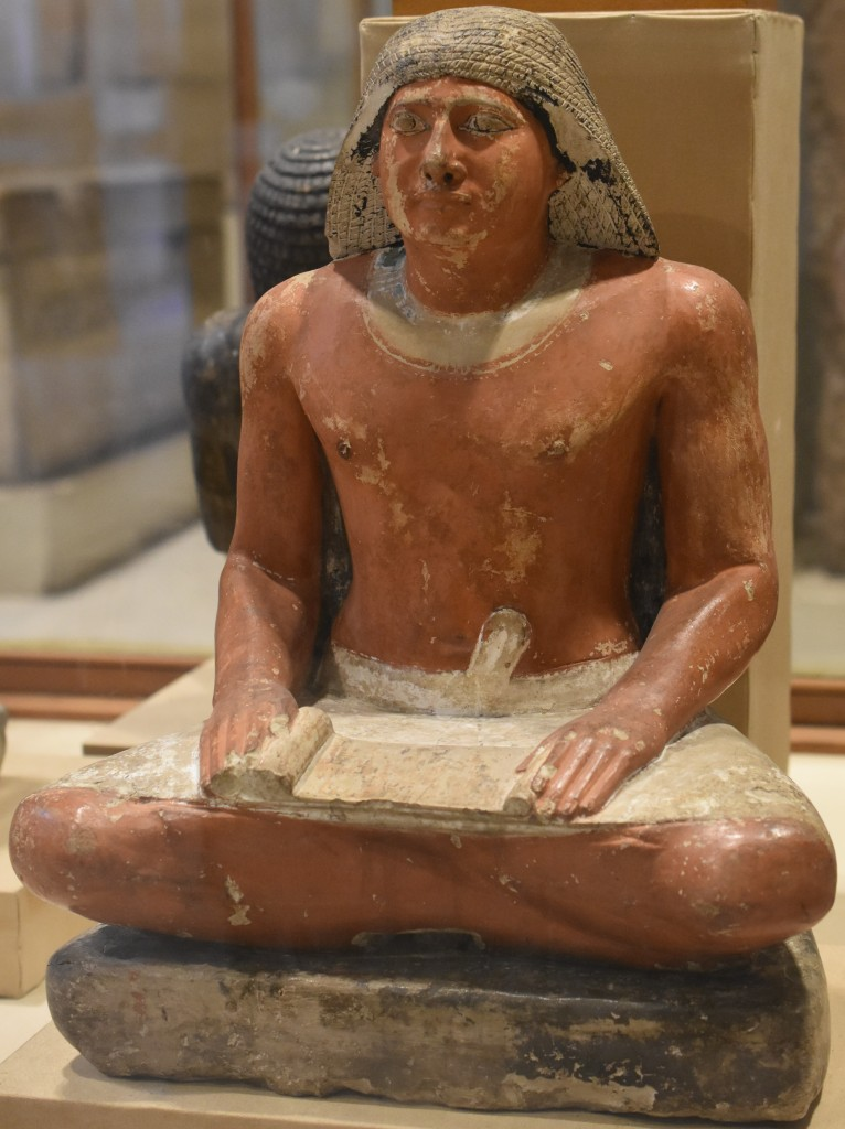 A statue of an Old Kingdom Egyptian official in scribal pose