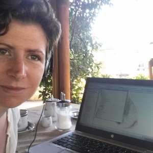 Image shows the author working at her GIS in Olynthos in 2015.