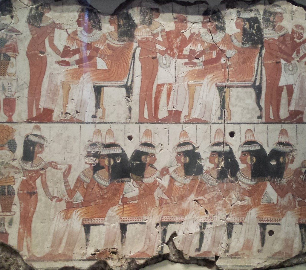 A scene from an ancient Egyptian tomb showing various guests at a party.